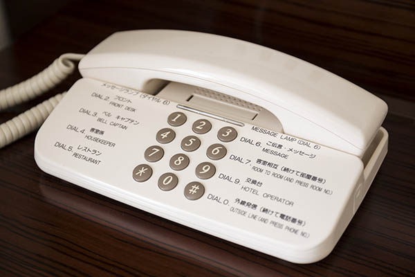 hotel in-house phone indicating number assist